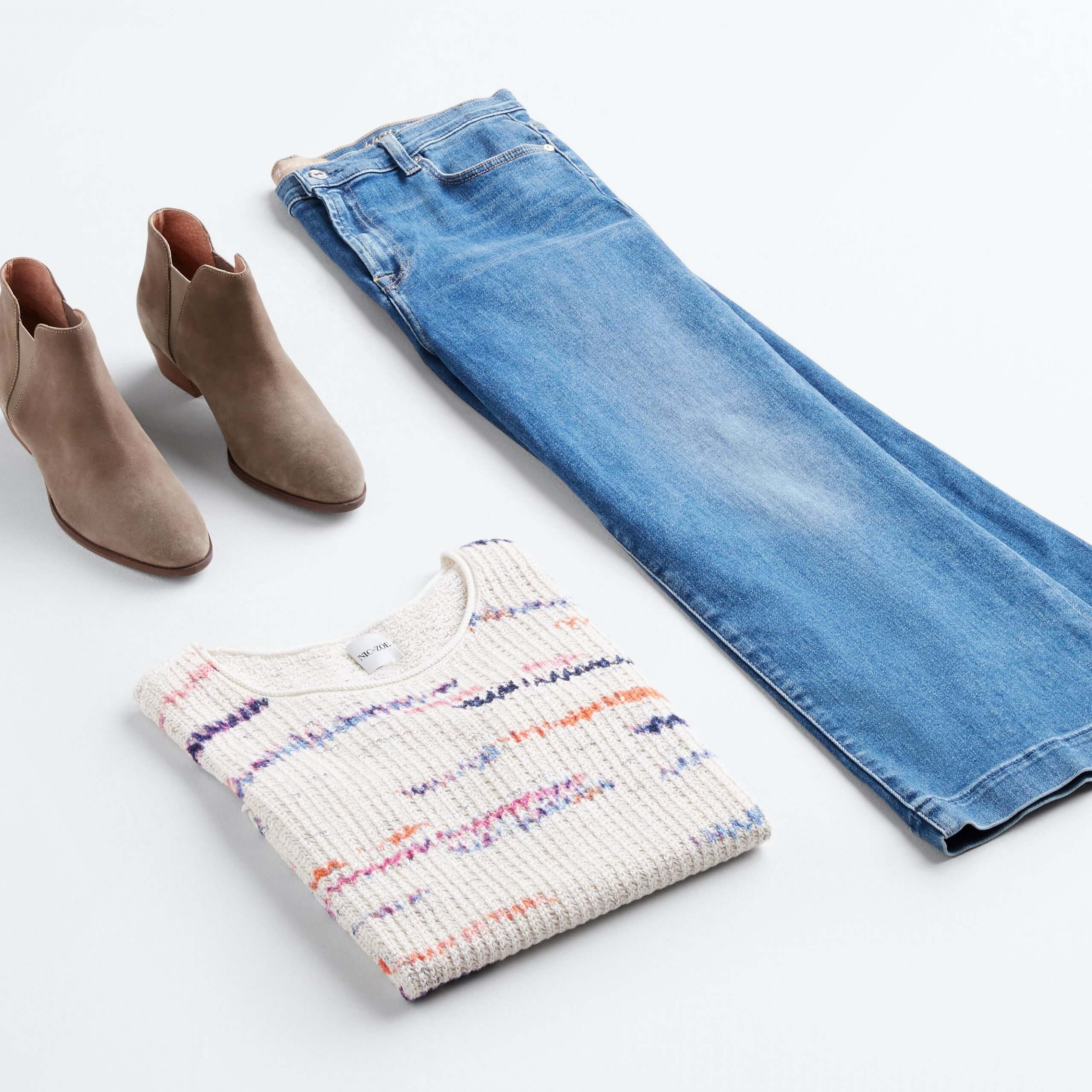 Stitch Fix outfit laydown featuring brown booties, off-white sweater and straight-leg, light-wash jeans.