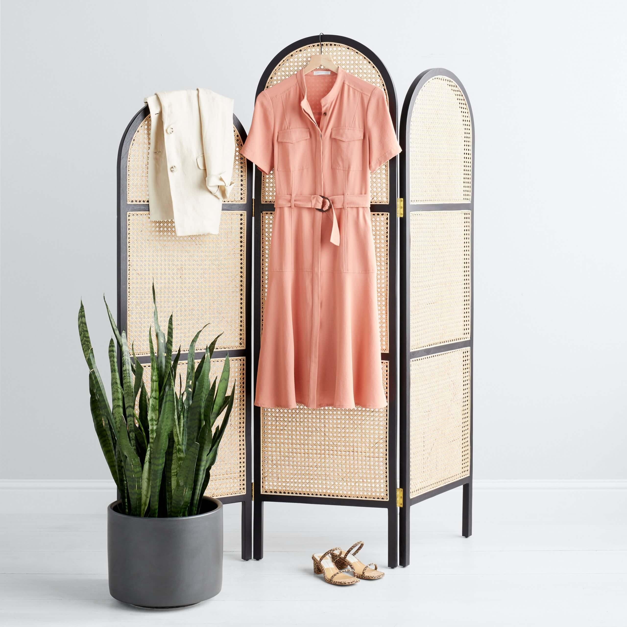 Stitch Fix Women's pink tie-waist shirt dress and cream blazer hanging on room divider with tan heels on the floor.