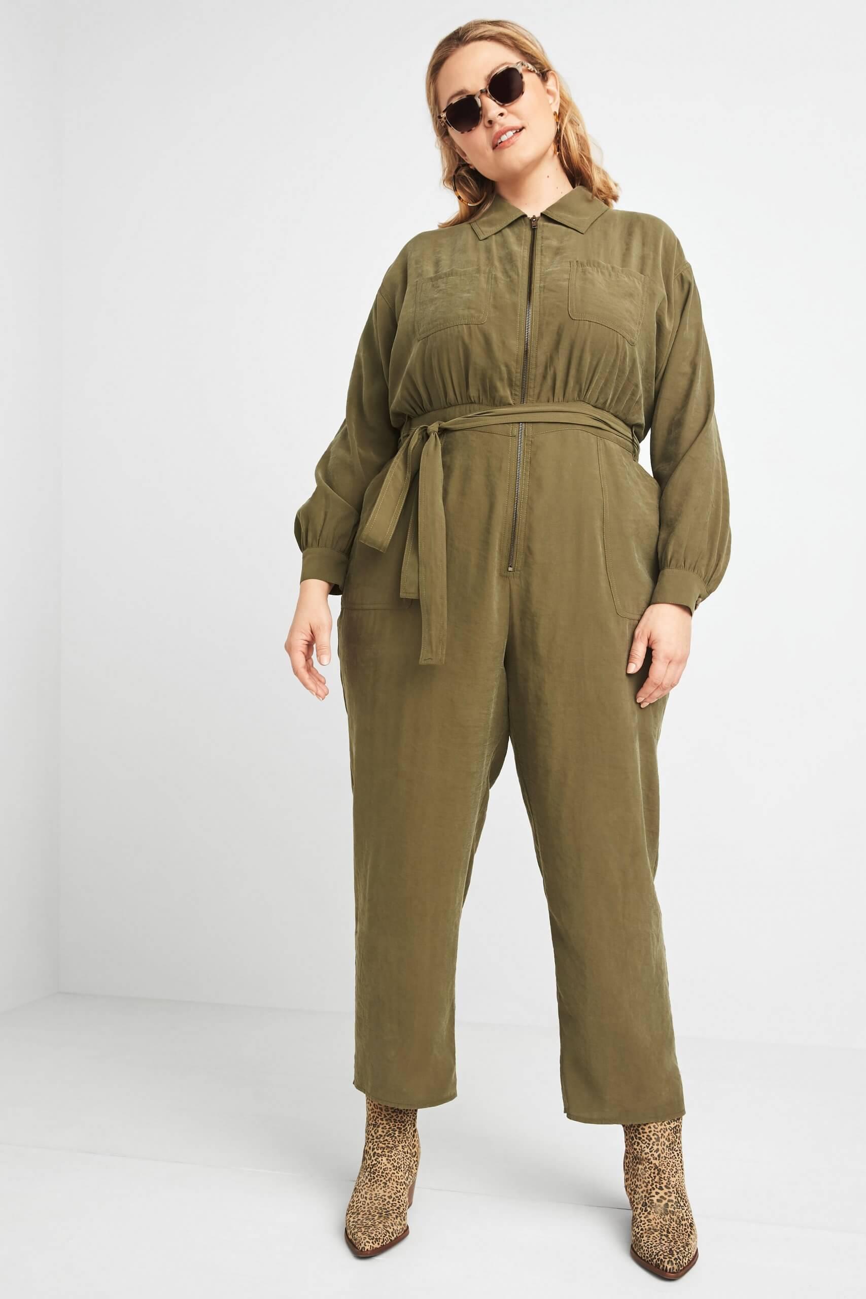 Stitch Fix Women's model wearing olive green long-sleeve jumpsuit with tie-waist.