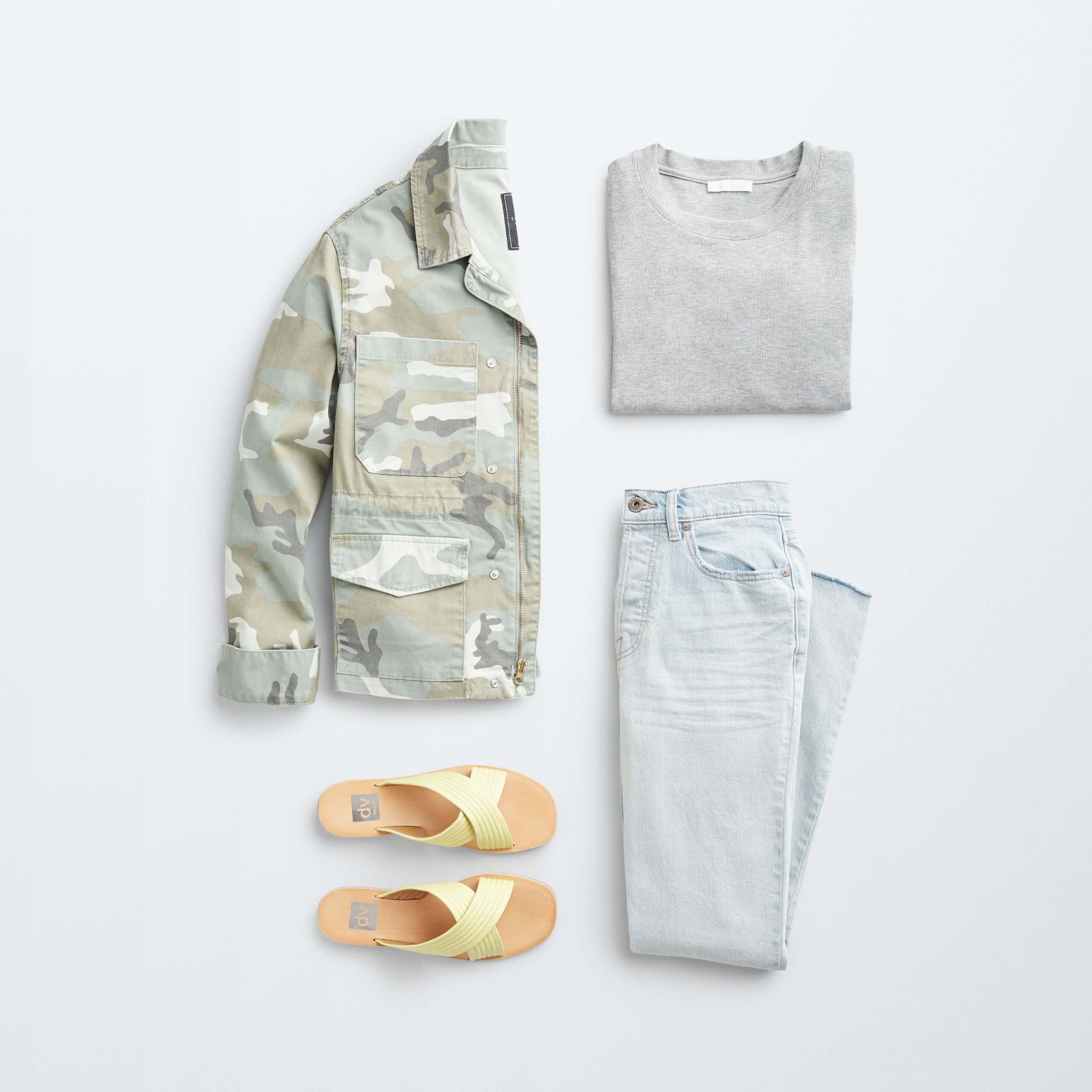 Stitch Fix women's outfit laydown featuring green camo utility jacket, grey pullover, light wash jeans and yellow slide sandals.