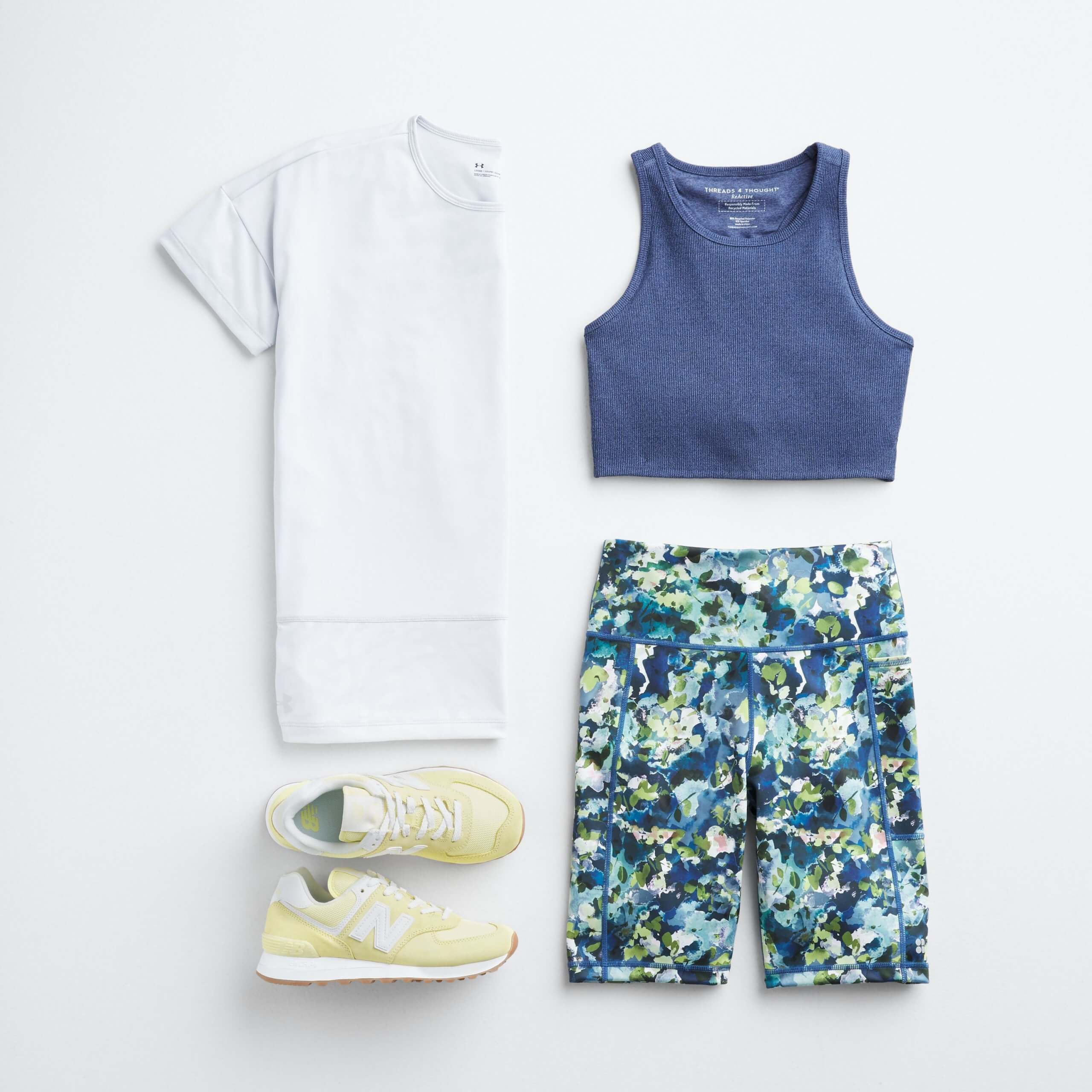 Stitch Fix Women's outfit laydown featuring white performance tee, blue sports bra, blue white and green splatter-print yoga shorts and yellow sneakers.