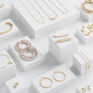 Stitch Fix women's gold stud and thread earrings, chain and bangle bracelets, hair clips and necklaces.
