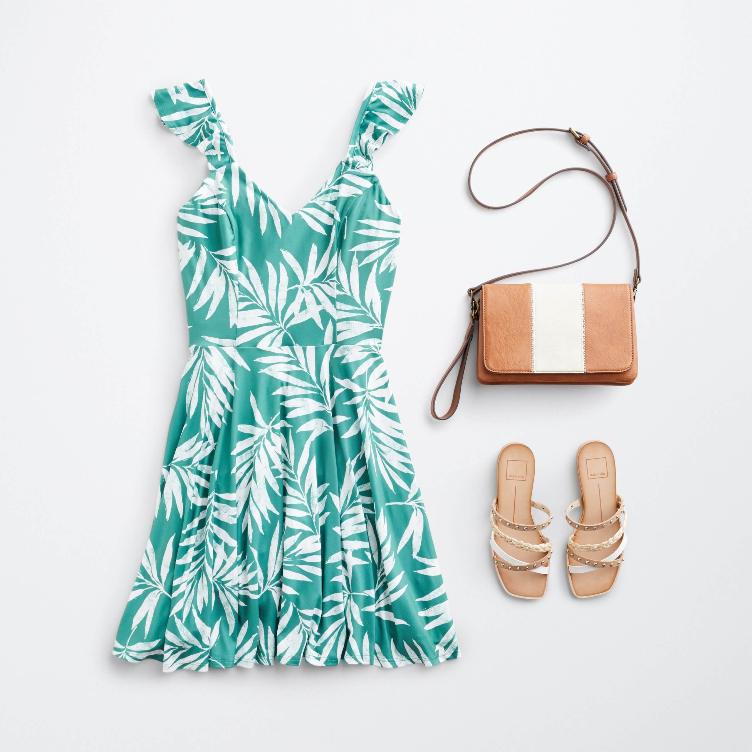 Stitch Fix women's outfit laydown featuring green tropical print dress, brown and white bag and strappy sandals.