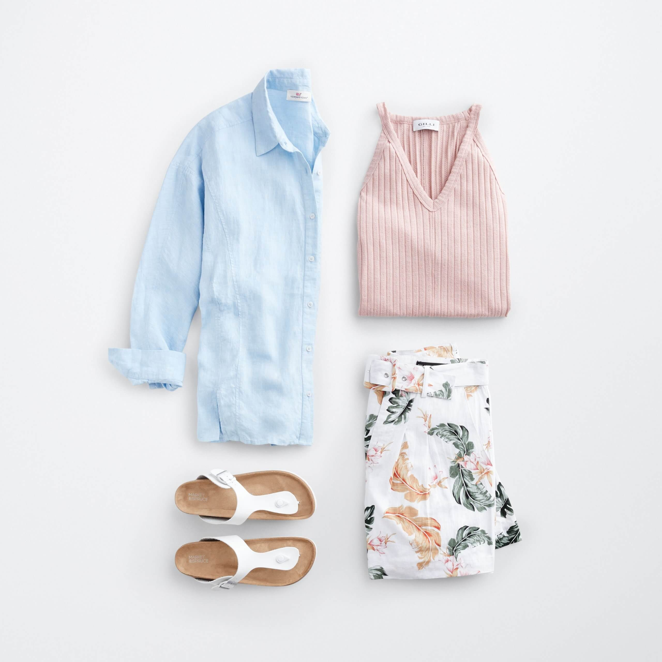 Stitch Fix Women's outfit laydown featuring a blue button-front shirt, light pink tank top, floral linen shorts and white sandals.