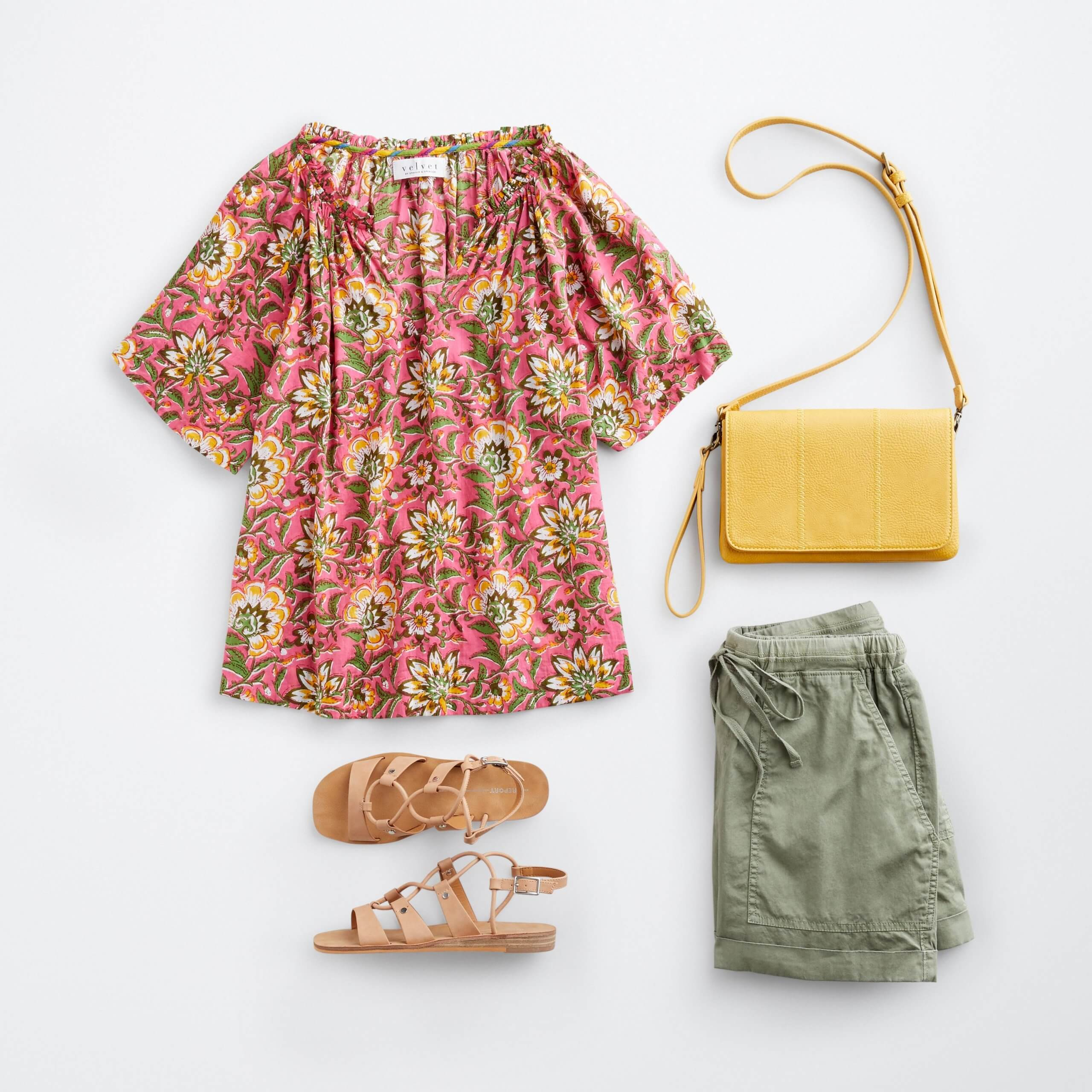 Stitch Fix women's boho outfit featuring red floral print top with yellow crossbody bag, olive green drawstring shorts and brown strappy sandals.