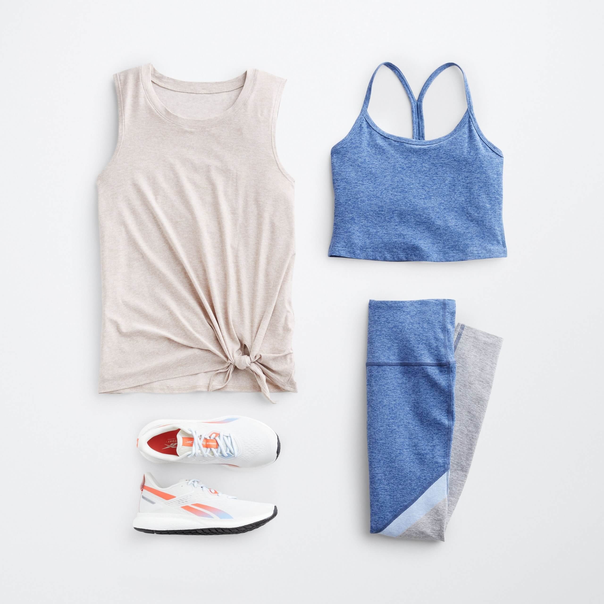 Stitch Fix Women's outfit laydown of off-white tank-top with tie front, blue cropped sports top, blue and grey leggings and white sneakers with orange details.