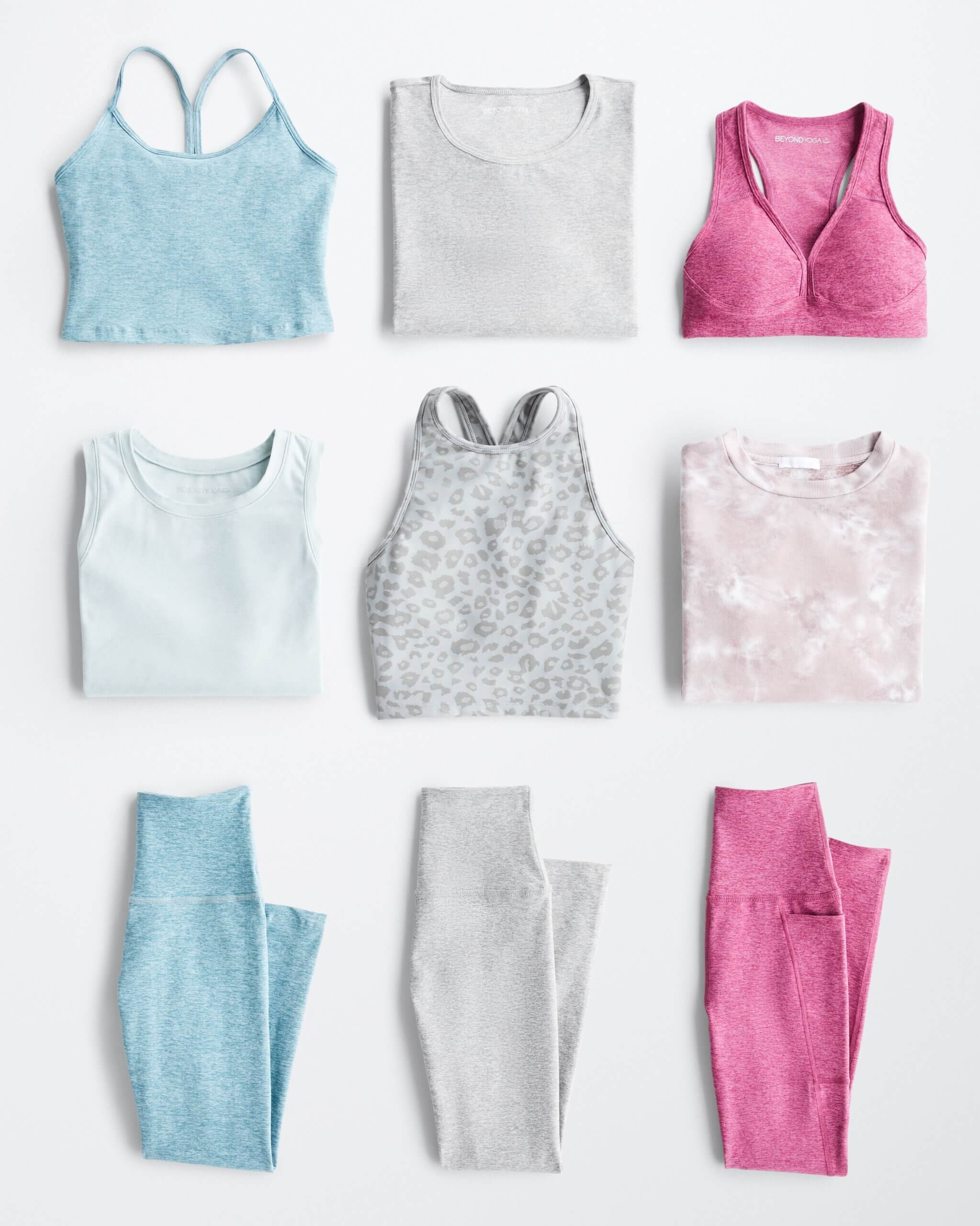 Stitch Fix Women's outfit laydown featuring sports bras, athletic tops and leggings in shades of blue, light grey and pink.