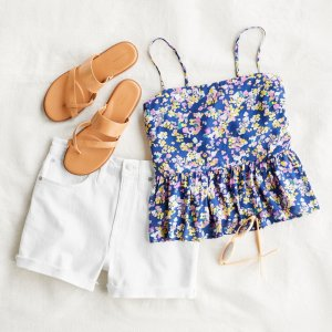 Stitch Fix women's outfit laydown featuring tan sandals, a floral tank top, yellow sunglasses and white shorts.