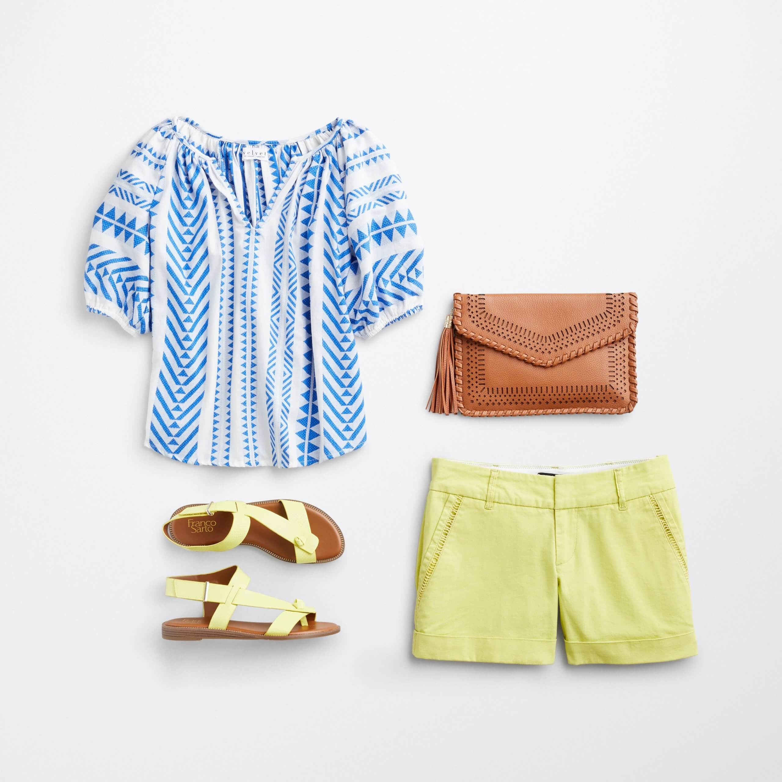 Stitch Fix Women's outfit laydown featuring blue and white printed shirt, brown clutch, yellow strappy sandals and yellow shorts.