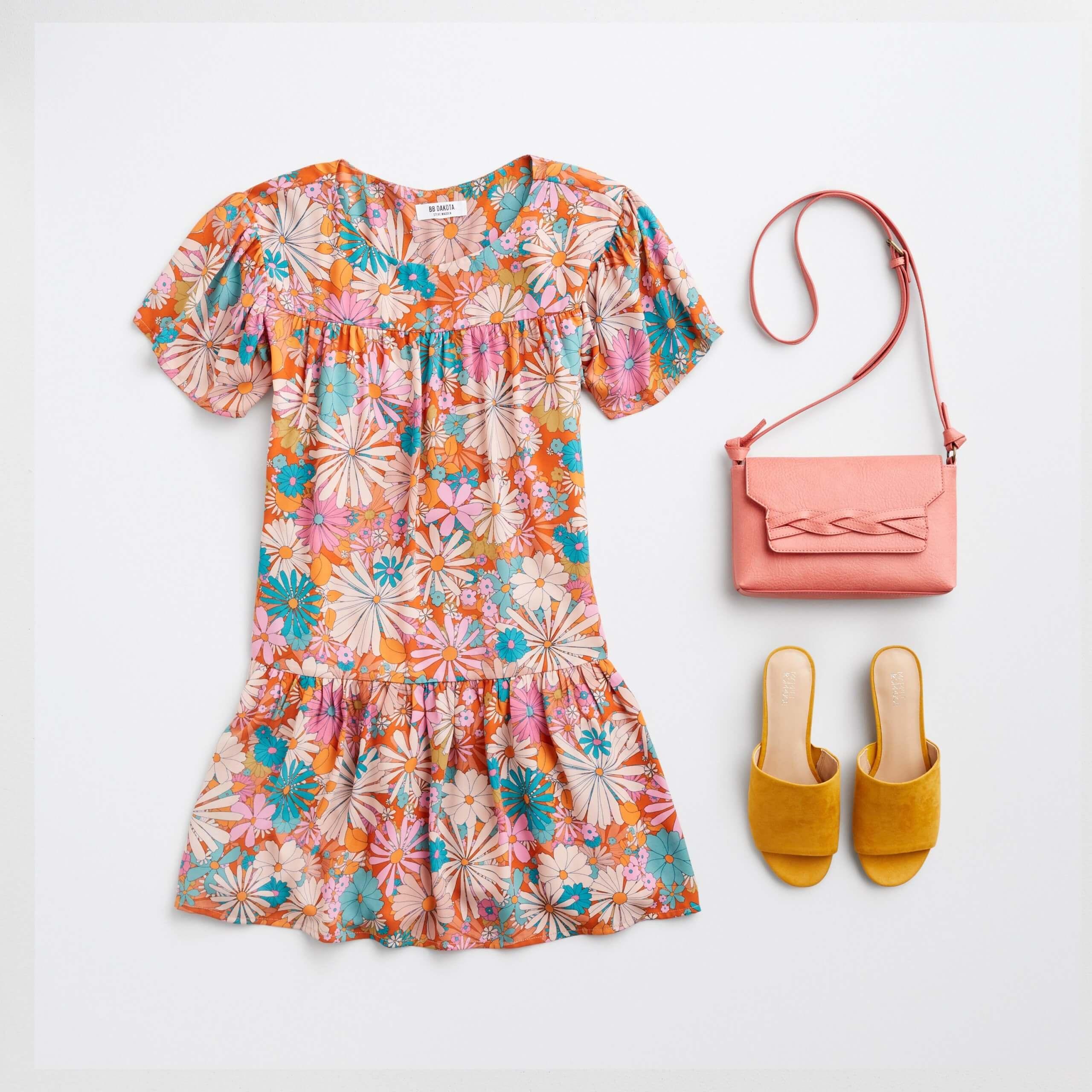 Stitch Fix Women's orange, pink and green floral printed short-sleeve shift dress, pink crossbody bag and mustard slide sandals.