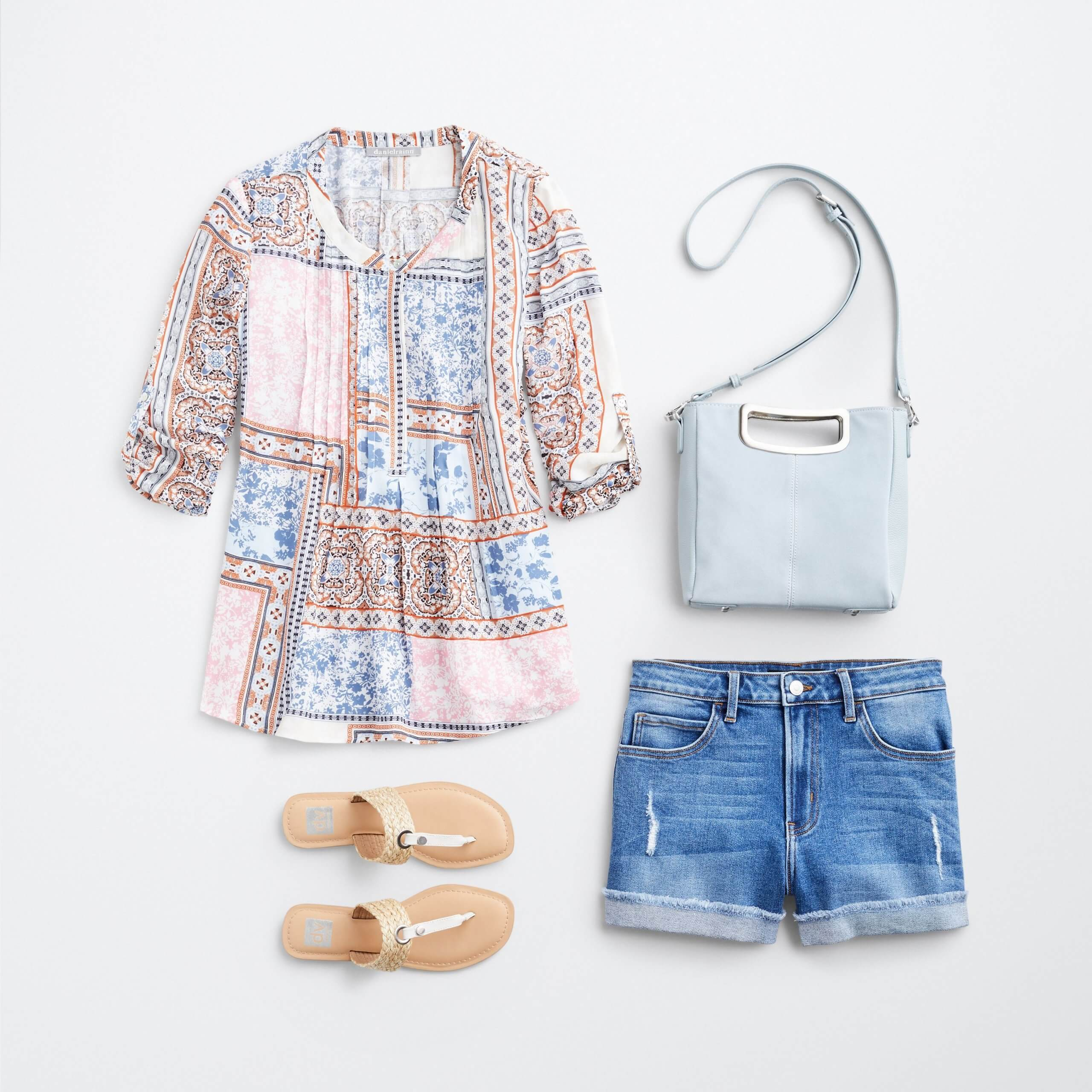 Stitch Fix Women's outfit laydown featuring pink, blue and burnt orange boho print top, white sandals, denim shorts and baby blue crossbody bag.