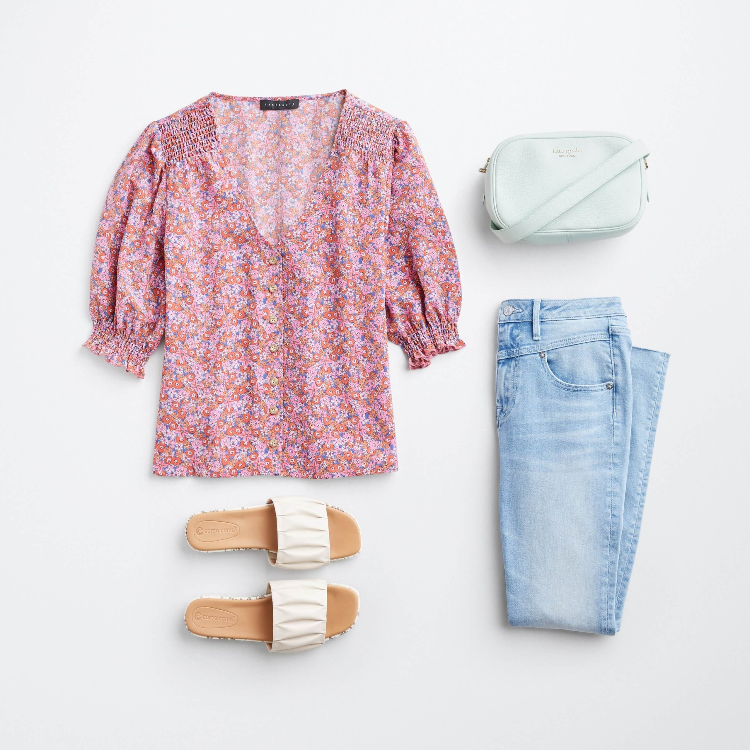 Stitch Fix Women's outfit laydown featuring multi-colored floral print top with mint green crossbody bag, light blue jeans and white slide sandals.
