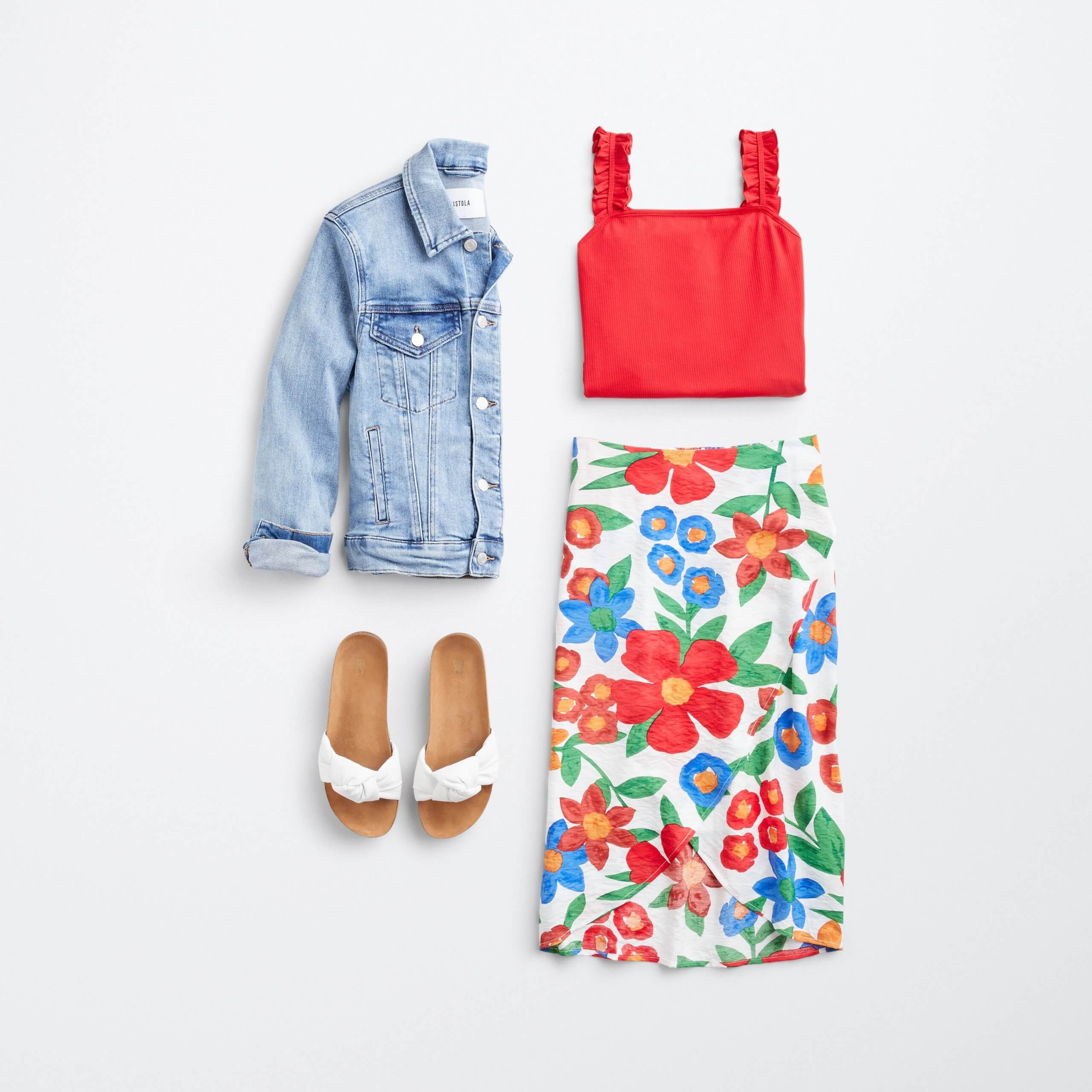 Stitch Fix women's outfit laydown featuring colorful floral print skirt, pink cropped tank, white slide sandals and denim jacket..