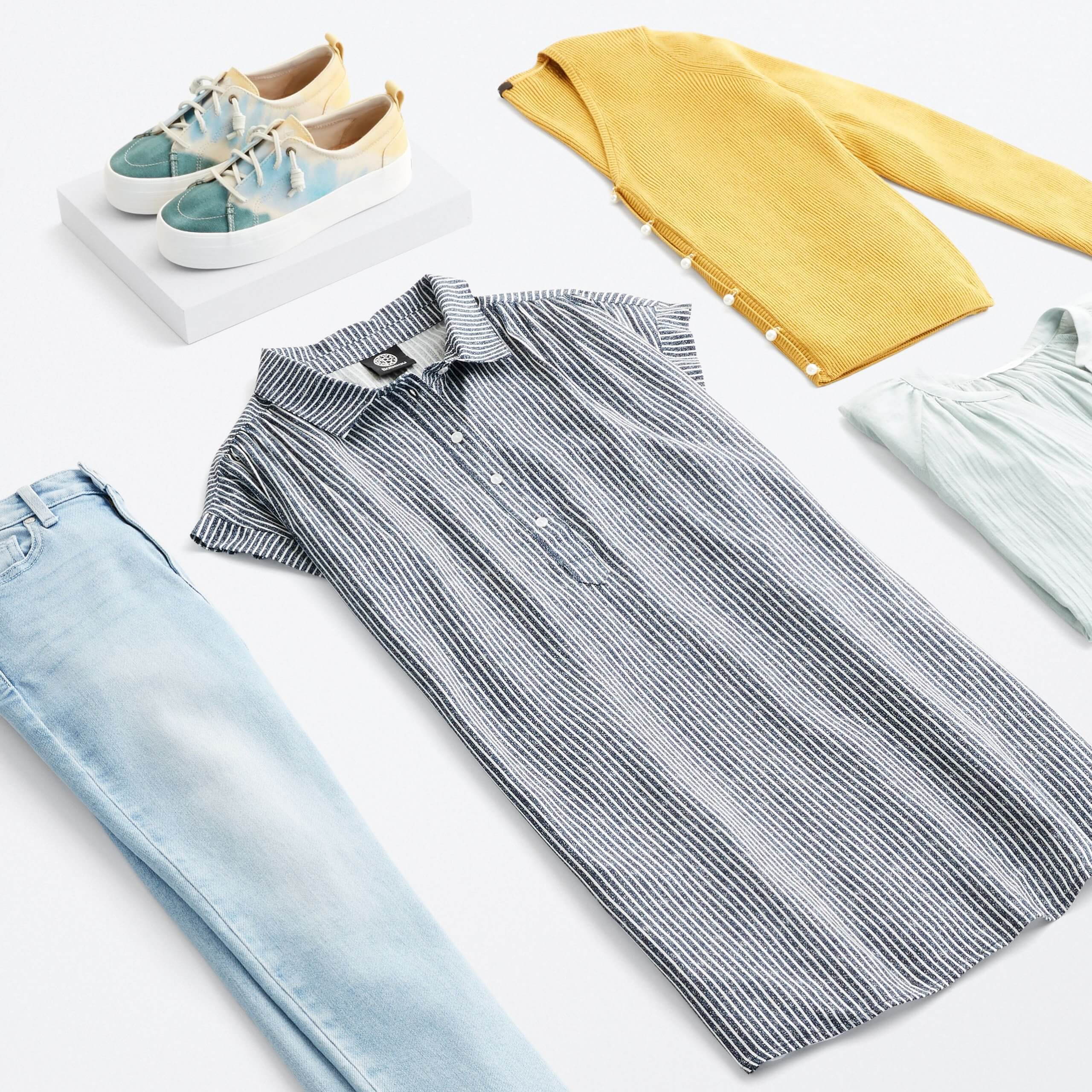 Stitch Fix Women's outfit laydown featuring grey striped collared dress, yellow cardigan, mint ruffle top, light wash jeans and green, blue and yellow tie-dye sneakers.