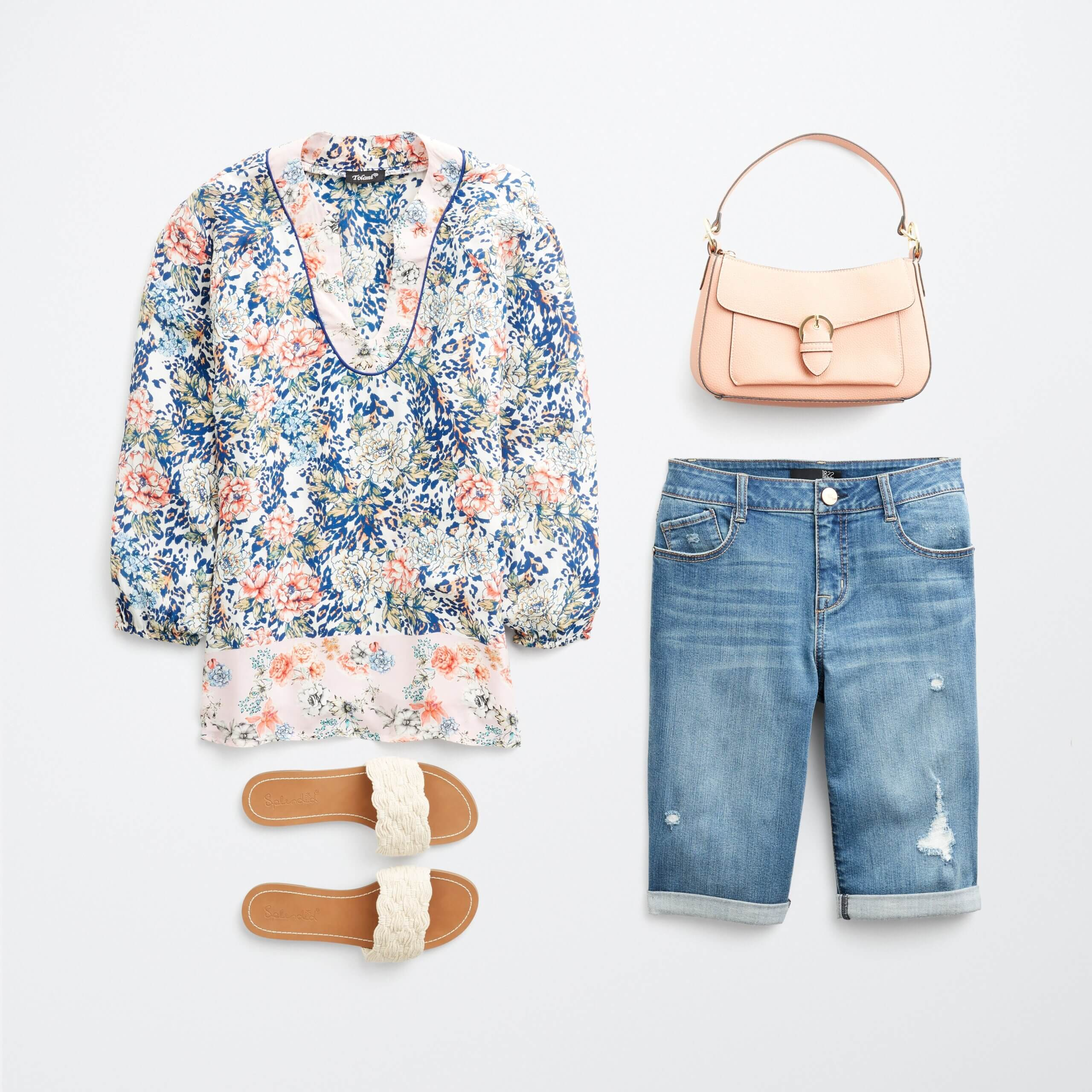 Stitch Fix Women's outfit laydown featuring blue, pink and cream printed blouse with blue denim bermuda shorts, pink purse and white slide sandals.