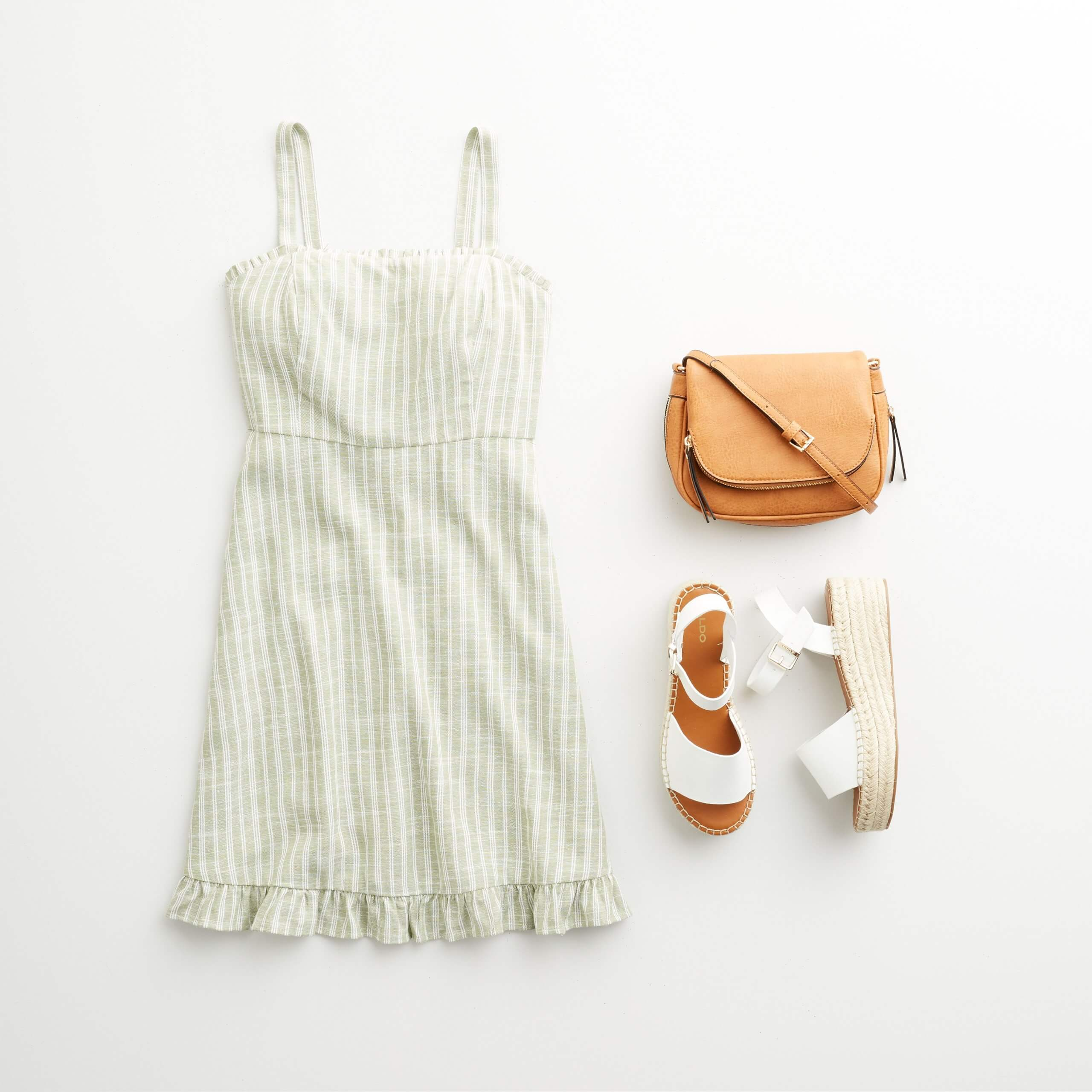 Stitch Fix Women's outfit laydown featuring green and white striped sundress, tan crossbody bag and white wedges.