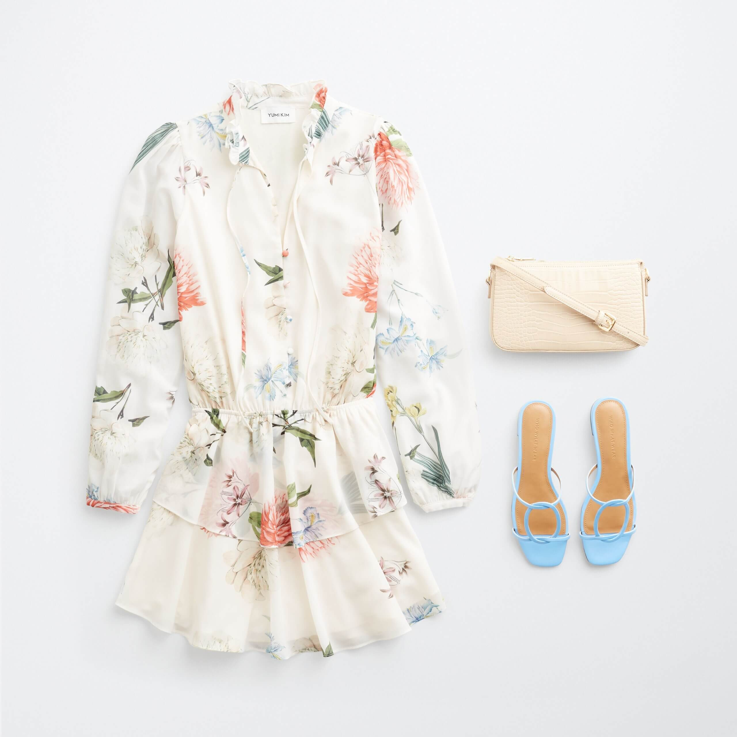 Stitch Fix women's outfit laydown featuring white floral romper, blue slide heeled sandals and cream crossbody bag.