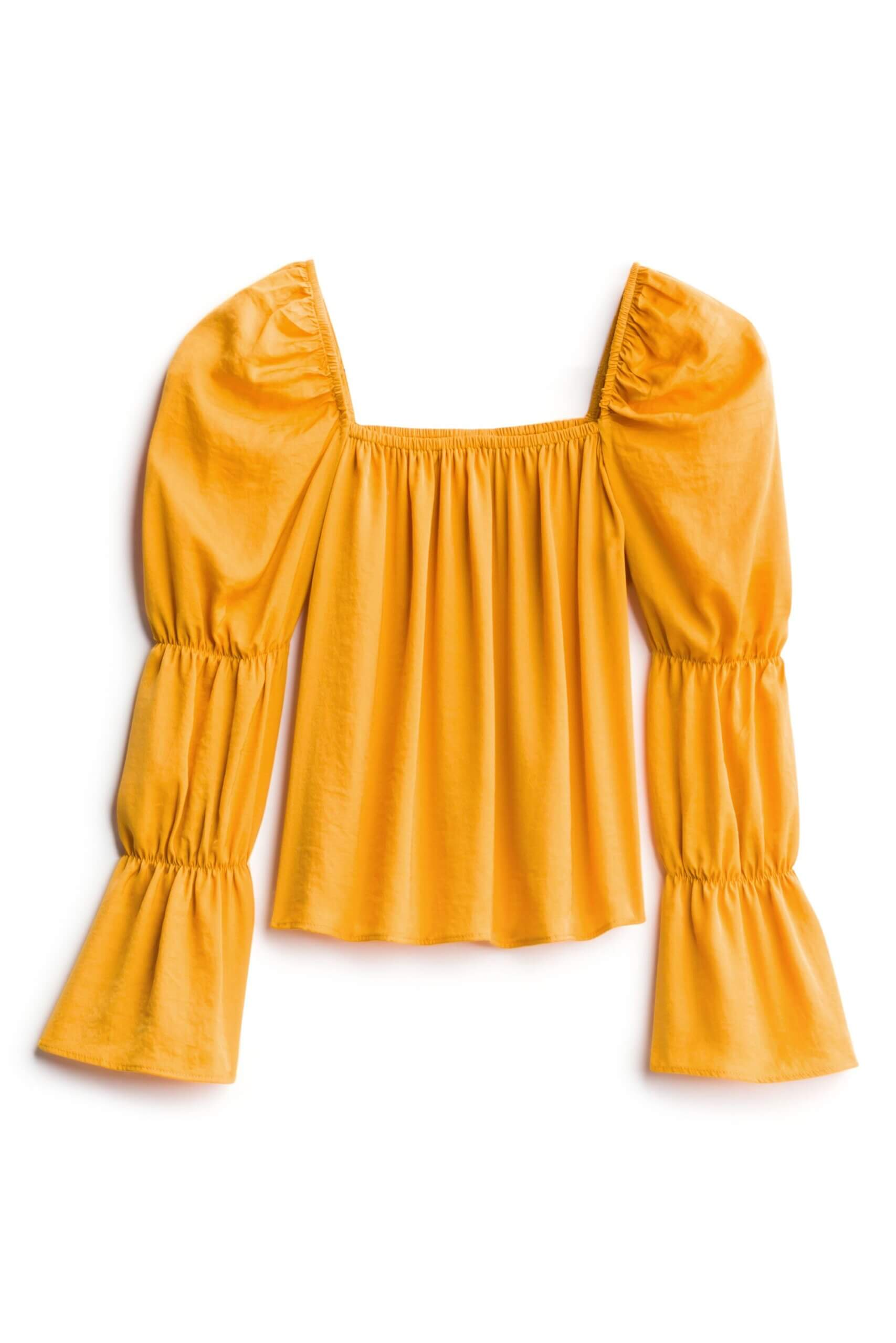 Stitch Fix Women's Summer 2021 Trends featuring mustard yellow long-sleeve blouse with tiered sleeves.