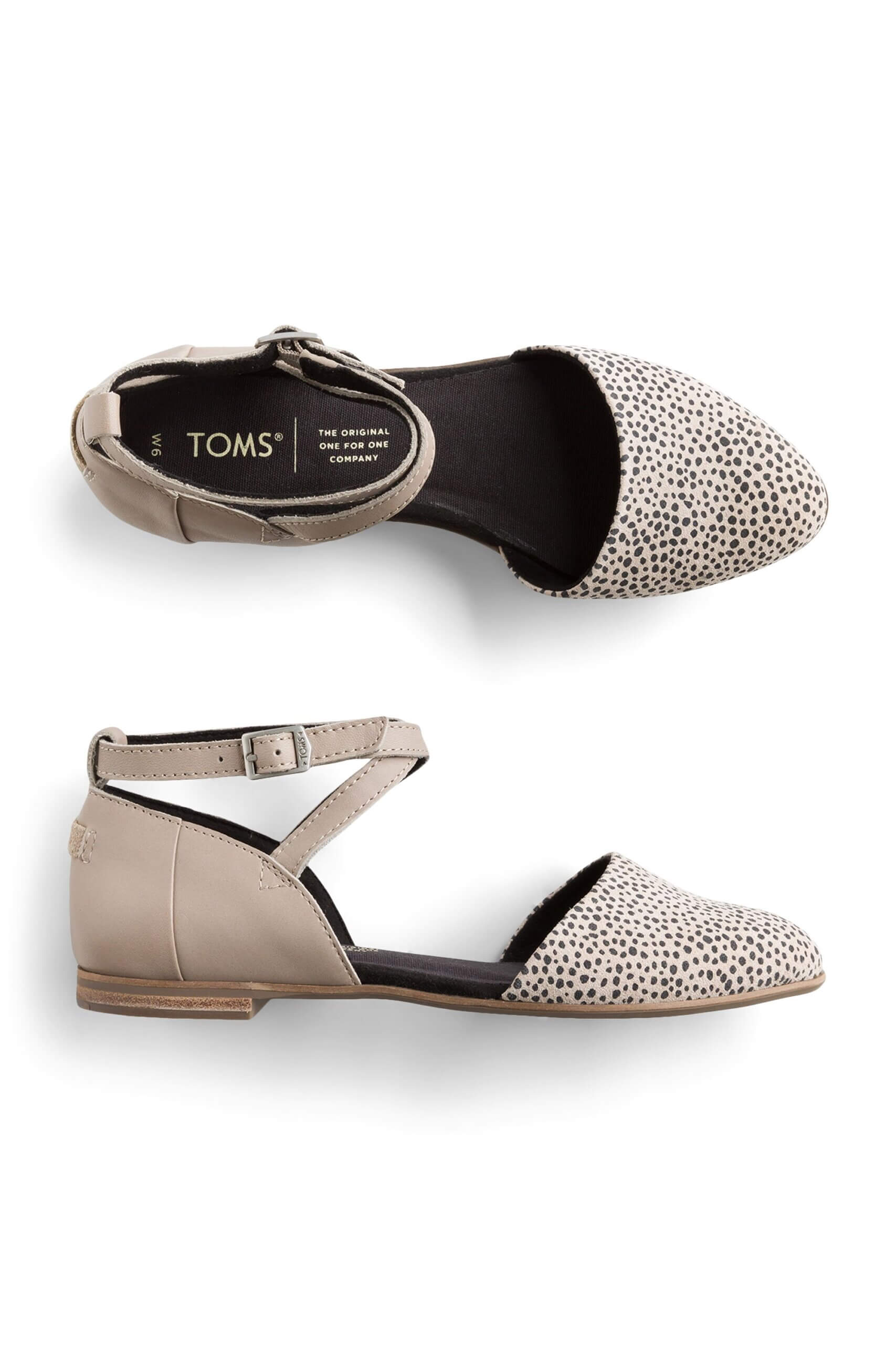 Stitch Fix Women's taupe ankle-strap flats with black spots.