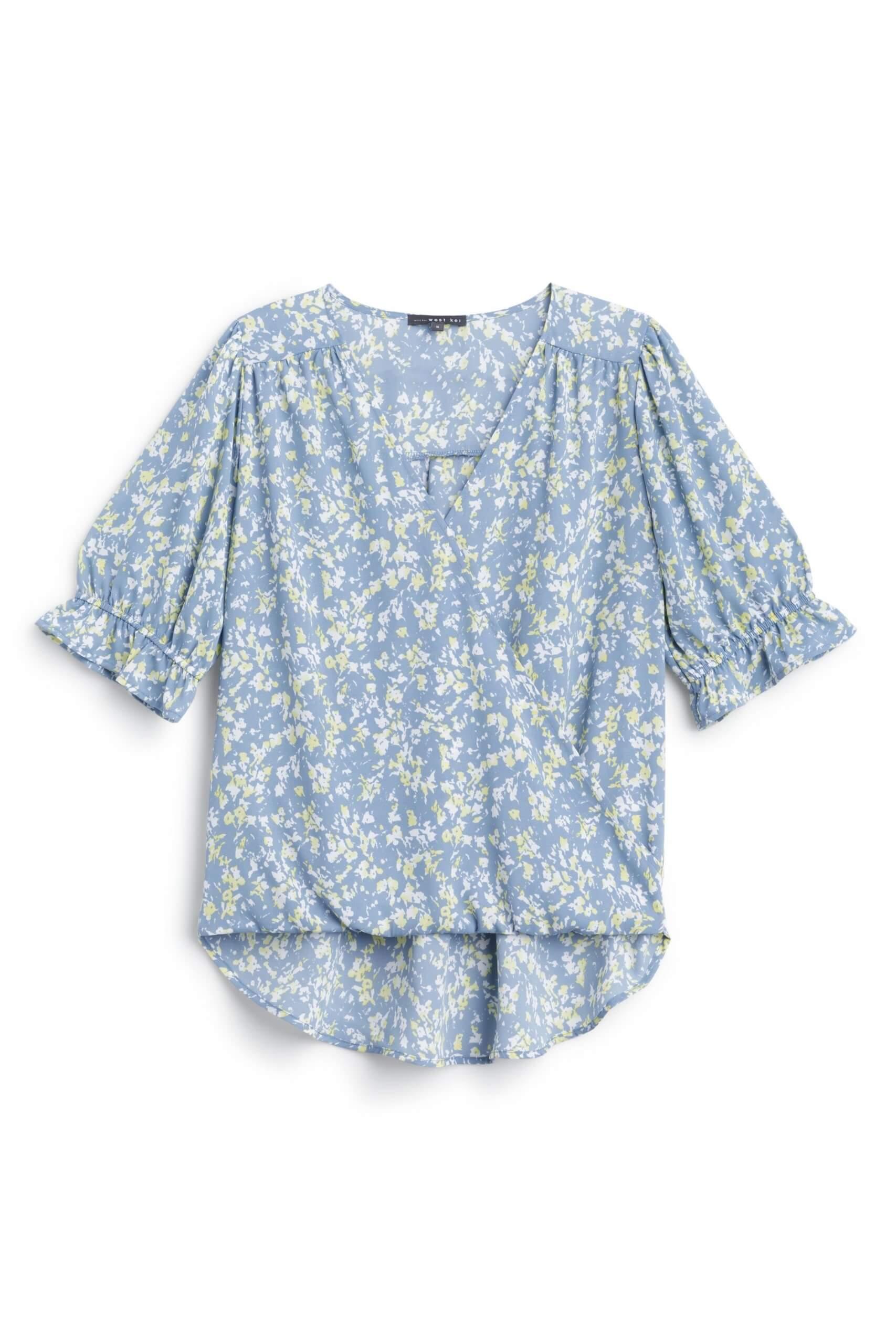 Stitch Fix Women's blue floral wrap shirt.