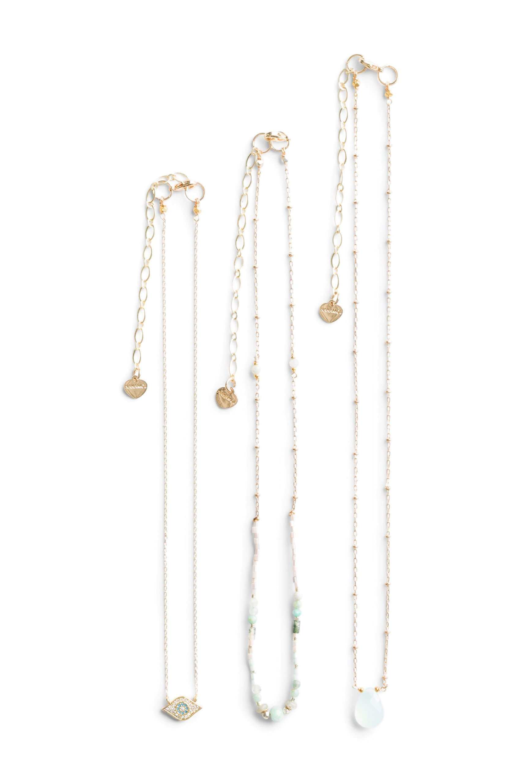 Stitch Fix Women's three-piece necklace set with gold chains and light blue beads.